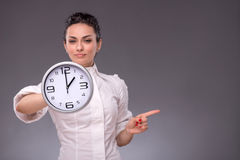 Portrait of nice girl holding big clock in her Stock Photography