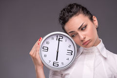 Portrait of nice girl holding big clock in her Royalty Free Stock Image