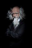 Portrait of nice handsome oldman in classic suit on black backgr Stock Images