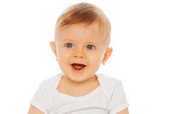 Portrait of nice laughing baby in white bodysuit royalty free stock photos
