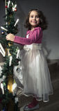 Portrait of nice little girl. In a white clothing before Christmas royalty free stock photos