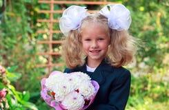 Portrait of nice little schoolgirl Stock Photos