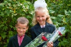 Portrait of nice little schoolgirl and schoolboy Stock Photos