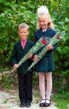 Portrait of nice little schoolgirl and schoolboy Royalty Free Stock Photography