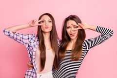 Portrait of nice-looking attractive lovely winsome flirty cheerful cheery straight-haired girls wearing casual showing v. Sign near eyes having fun isolated royalty free stock photography