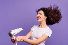 Portrait of nice-looking cute winsome lovely lovable attractive cheerful cheery groomed wavy-haired lady drying strong stock photo