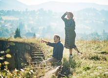 Male and female relationships in mountains outdoors stock photography