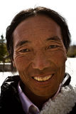 Portrait of a nice smiling man from Tibet Royalty Free Stock Photos