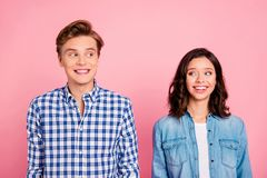 Portrait of nice sweet charming lovely attractive cheerful cheer. Y positive confused flirty couple isolated over pink pastel background stock photo