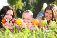 Portrait of a nice teenagers with fruits Stock Photos