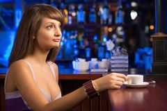 Portrait of a nice woman at the bar Royalty Free Stock Photos
