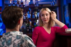 Portrait of a nice woman at the bar Stock Image