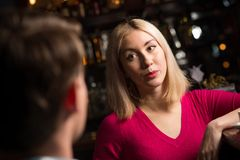 Portrait of a nice woman at the bar Stock Photos