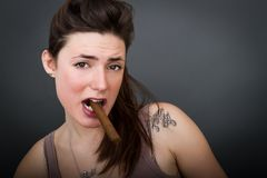 Portrait for a nice woman smokes cigar Stock Photo