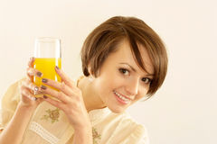 Portrait of a nice woman with juice Stock Photography