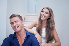 Portrait of nice young couple in summer house Stock Photography