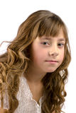 Portrait of nine years old girl. With curly hair isolated on white royalty free stock photo