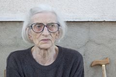 Portrait of a ninety years old grandma with walking stick outdoo Royalty Free Stock Photo