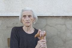 Portrait of a ninety years old grandma with walking stick outdoo Royalty Free Stock Images