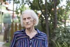 Portrait of a ninety years old woman outdoors Stock Images