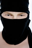 Portrait of ninja man in a black mask on white background Stock Photography