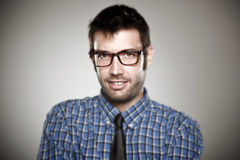 Portrait of a normal boy with glasses over grey background. Stock Photos