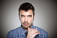 Portrait of a normal boy over grey background. Royalty Free Stock Photos