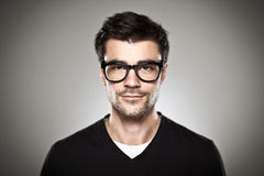Portrait of a normal boy with rimmed glasses Stock Images