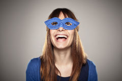 Portrait of a normal girl laughing with a blue mask Stock Photos
