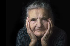 Portrait of a nostalgic elderly woman. Evoking the past. Stock Photos