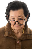 Portrait of nostalgic sad grandmother looking down Royalty Free Stock Images