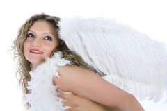 Portrait of the nude blonde-angel with blue eyes royalty free stock image