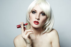 Portrait of nude elegant woman with blonde hai. R and red lipstick stock photos
