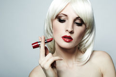 Portrait of nude elegant woman with blonde hai. R and red lipstick Stock Images