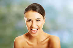 Portrait of nude woman laughing loud Royalty Free Stock Photography