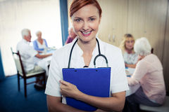 Portrait of a nurse with clipboard Royalty Free Stock Image