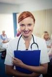 Portrait of a nurse with clipboard Stock Photos