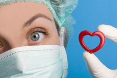 Portrait of nurse holding a small heart Royalty Free Stock Photos
