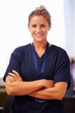Portrait Of Nurse In Hospital Wearing Scrubs Royalty Free Stock Photos