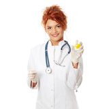 Portrait of a nurse making a drip Royalty Free Stock Photo