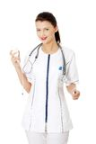 Portrait of a nurse making a drip Royalty Free Stock Photography