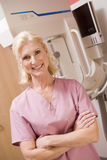Portrait Of A Nurse With Mammogram Machine Royalty Free Stock Photos