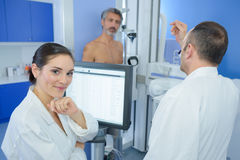 Portrait nurse man being xrayed in background Royalty Free Stock Photography