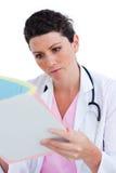 Portrait of nurse reading documents Royalty Free Stock Photo
