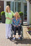 Portrait of Nurse with Senior Woman in Wheelchair Royalty Free Stock Images