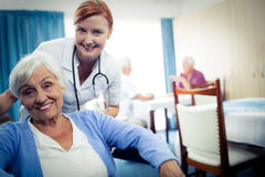 Portrait of nurse with a senior woman Stock Photos
