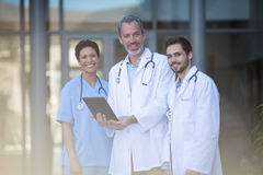 Portrait of nurse and surgeon using digital tablet. Of hospital Royalty Free Stock Images
