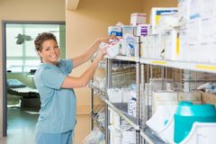 Portrait Of Nurse Working In Storage Room Stock Photos