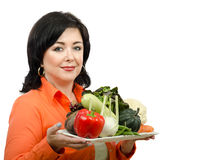 Portrait of nutrition coach with a tray of fresh vegetables Stock Images