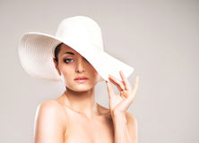 Portrait o a young woman posing in a white hat Royalty Free Stock Photo